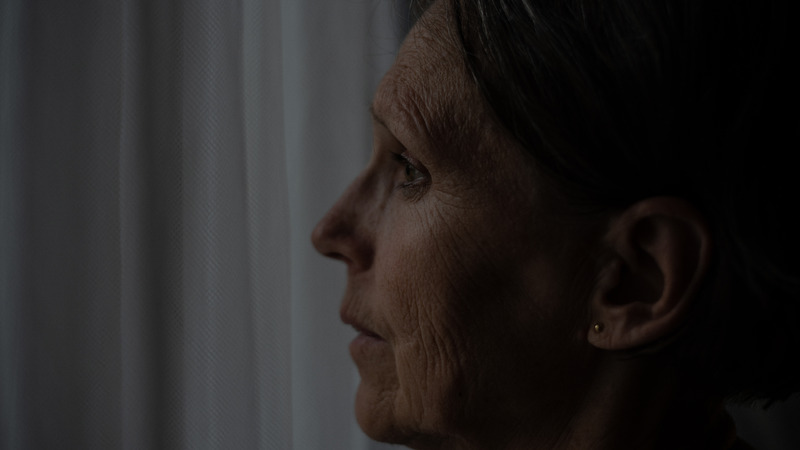an old woman with fine lines and wrinkles on her face
