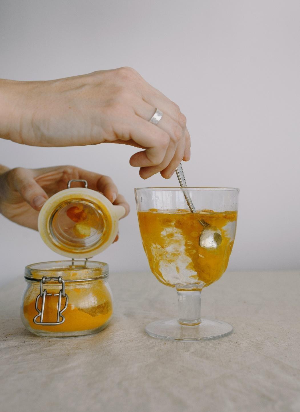 a cup of turmeric tea-a turmeric as added to water to make a turmeric tea