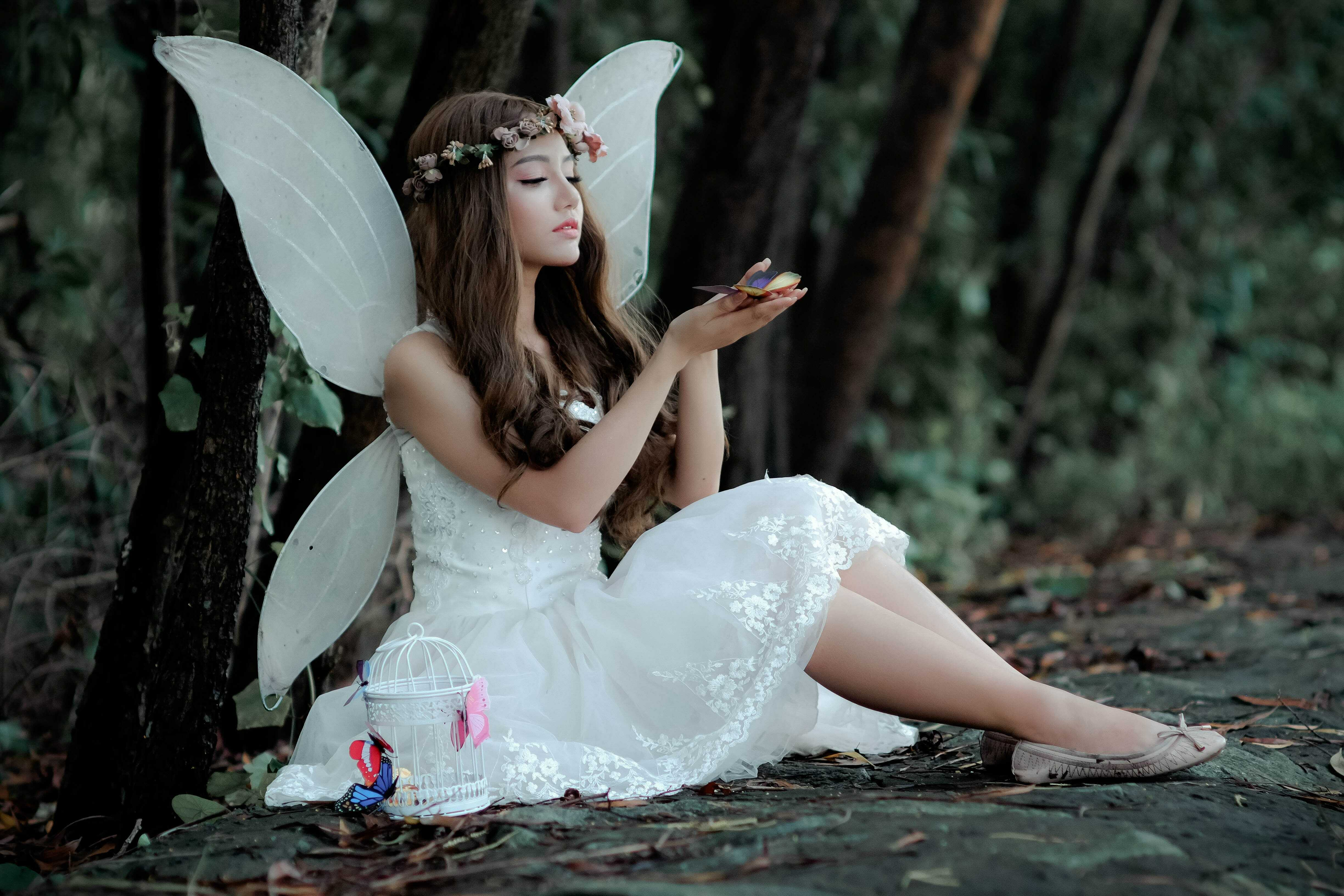 a girl with wings like butterfly