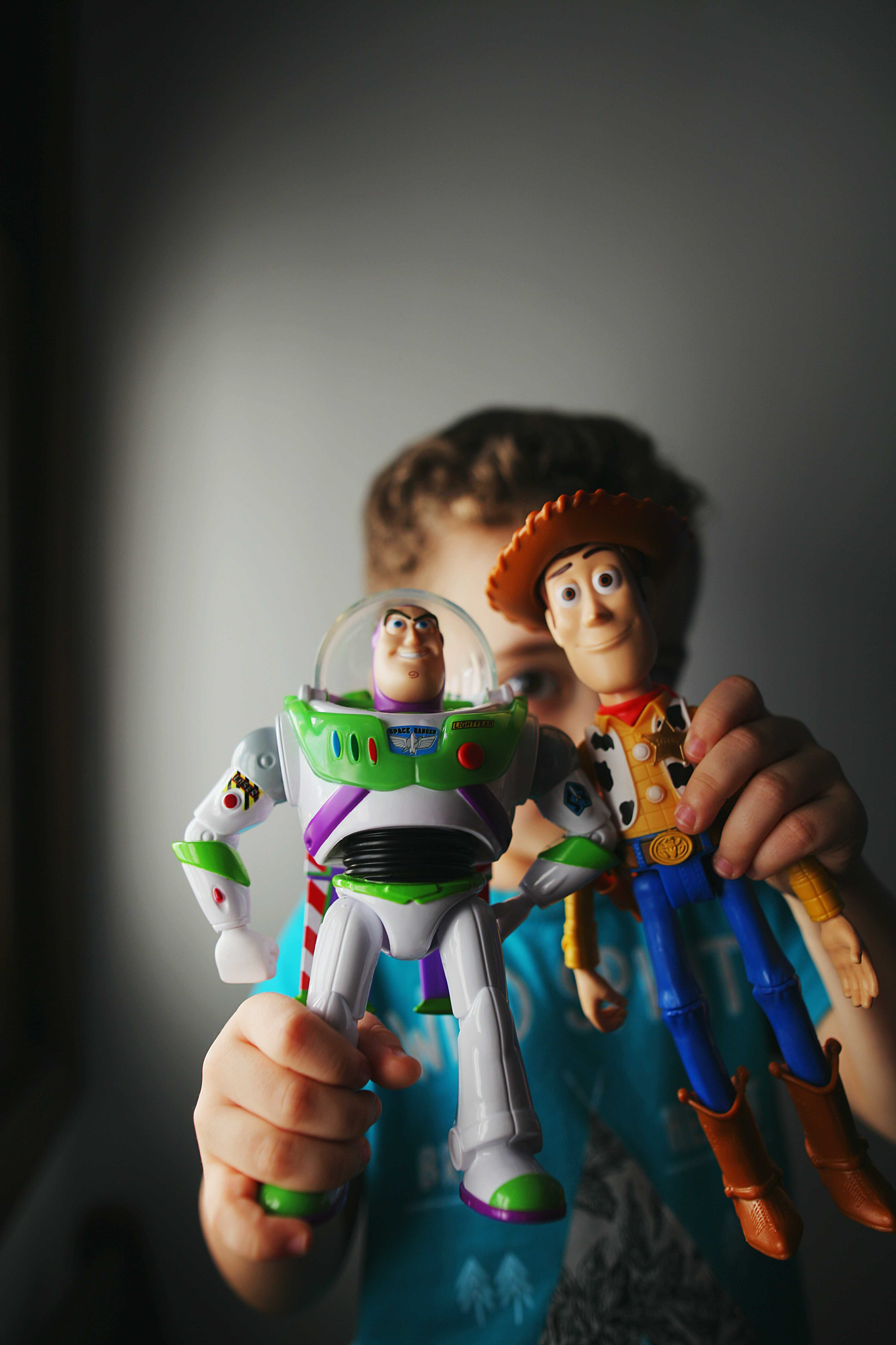 a boy with toy story toys