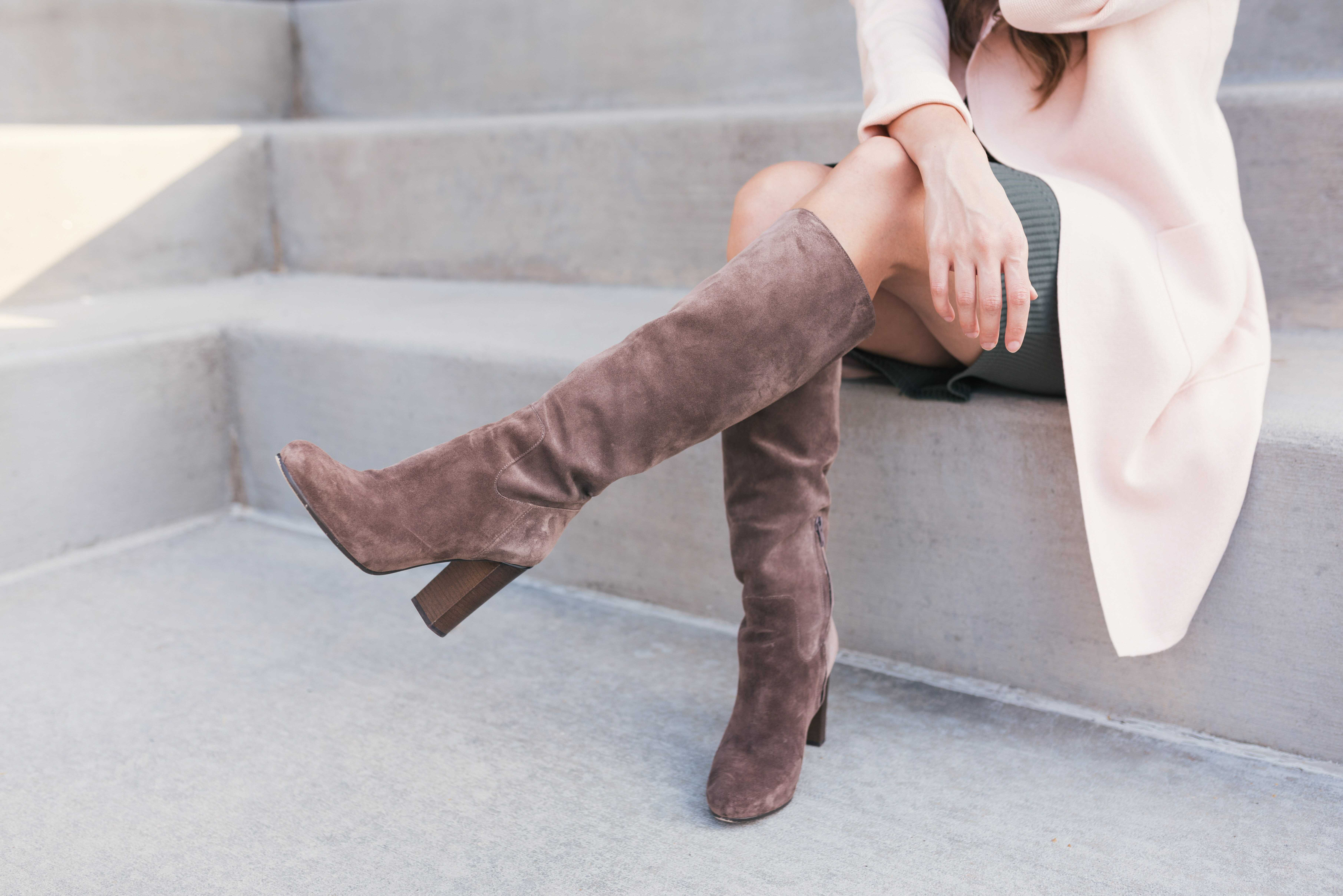 a long boot with beige color