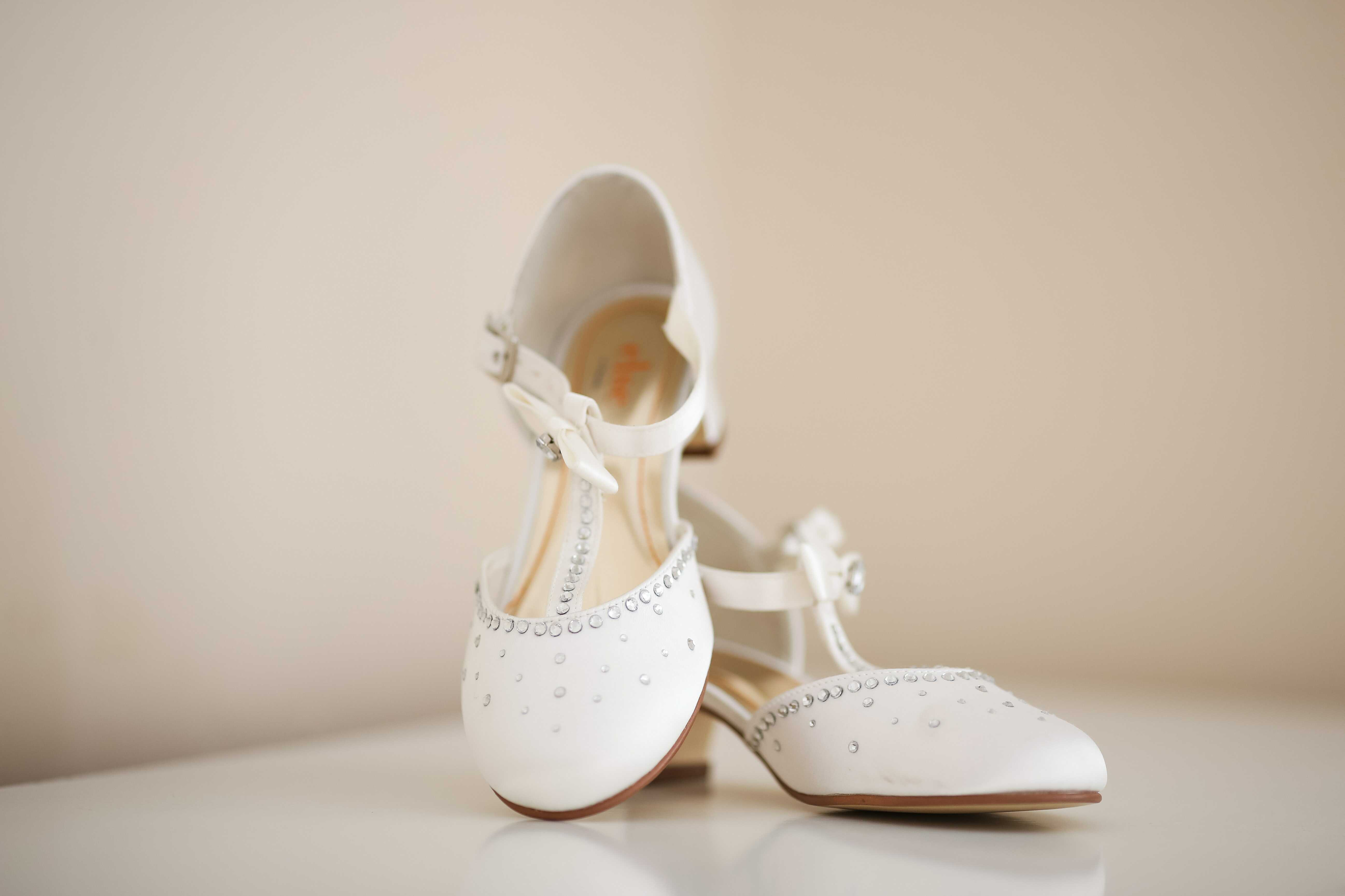 a white t-shaped strap heels