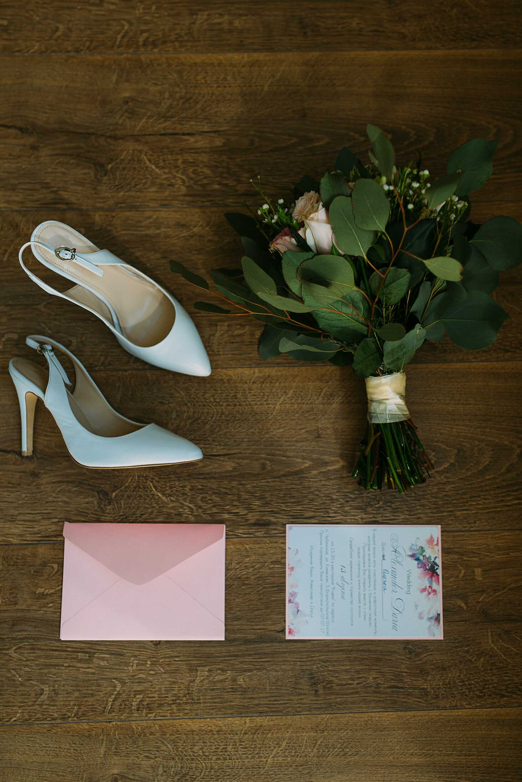 a white sling back heels with flower bouquet and a letter