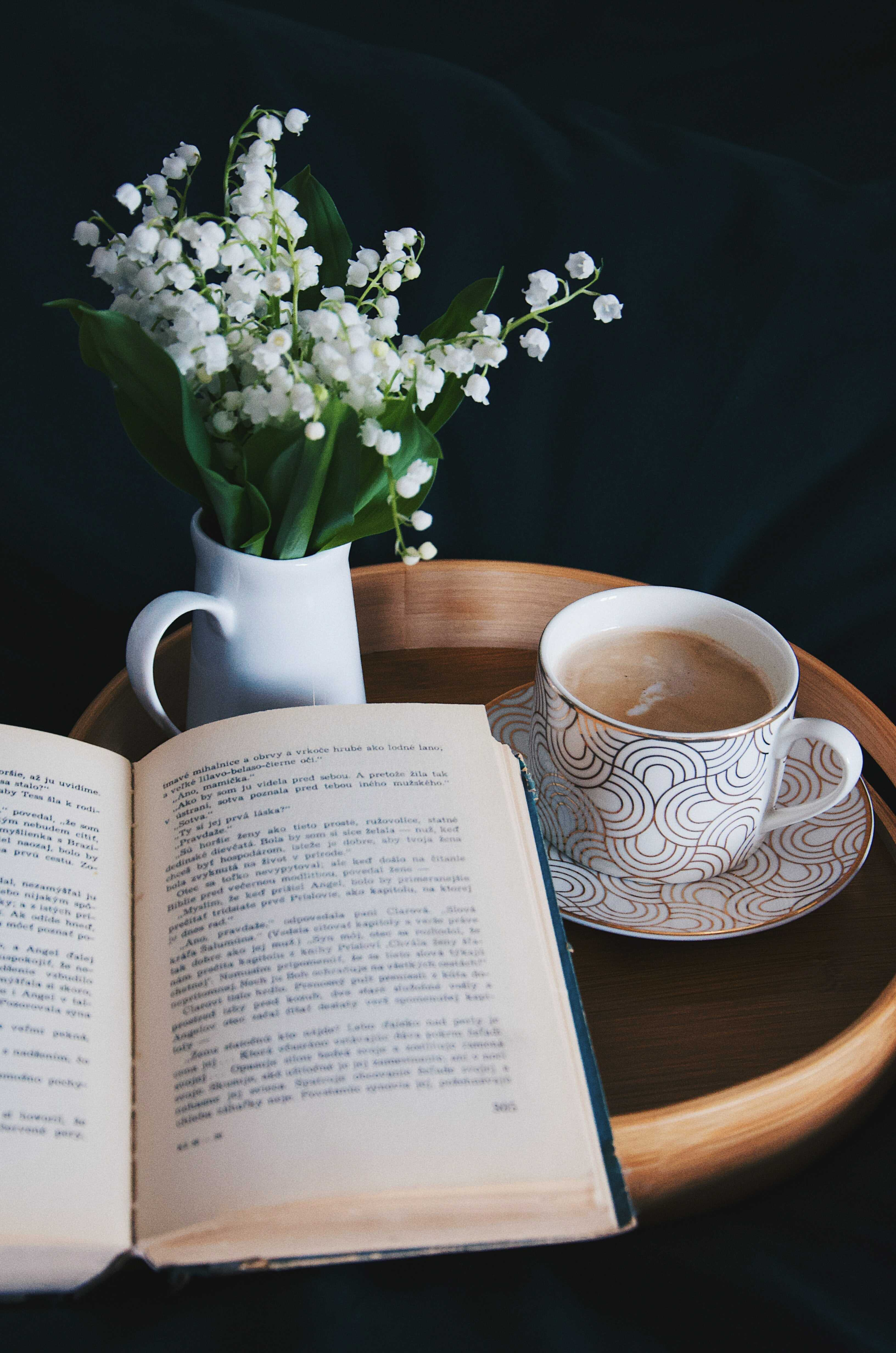 a cup of latte and a book