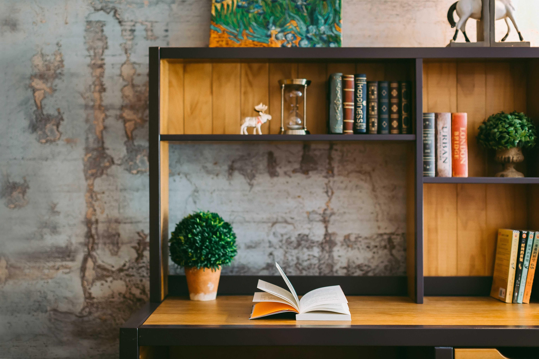 a brown book shelves