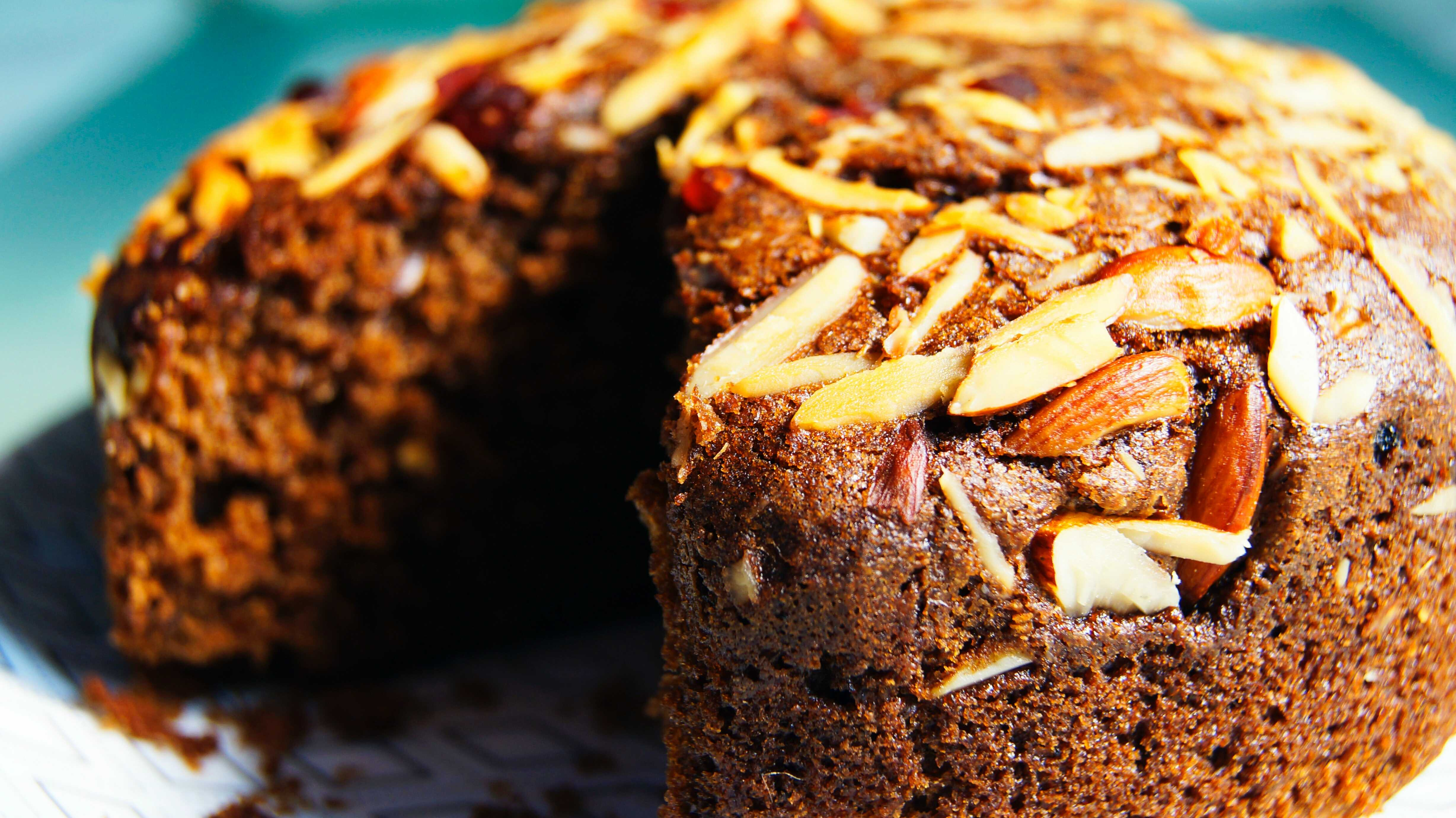 a chocolate cake with almonds