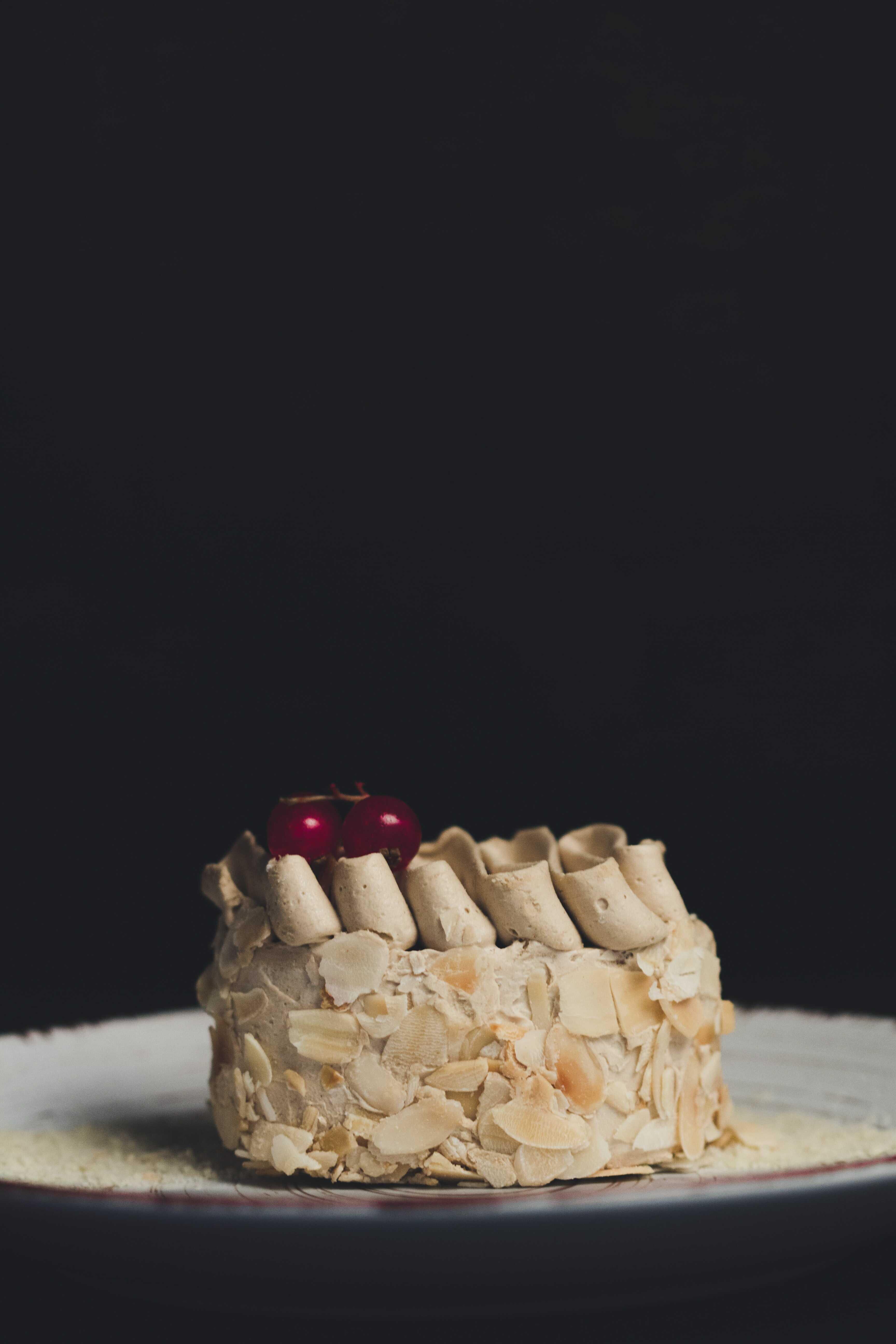 a slice of vanilla almond coconut cake
