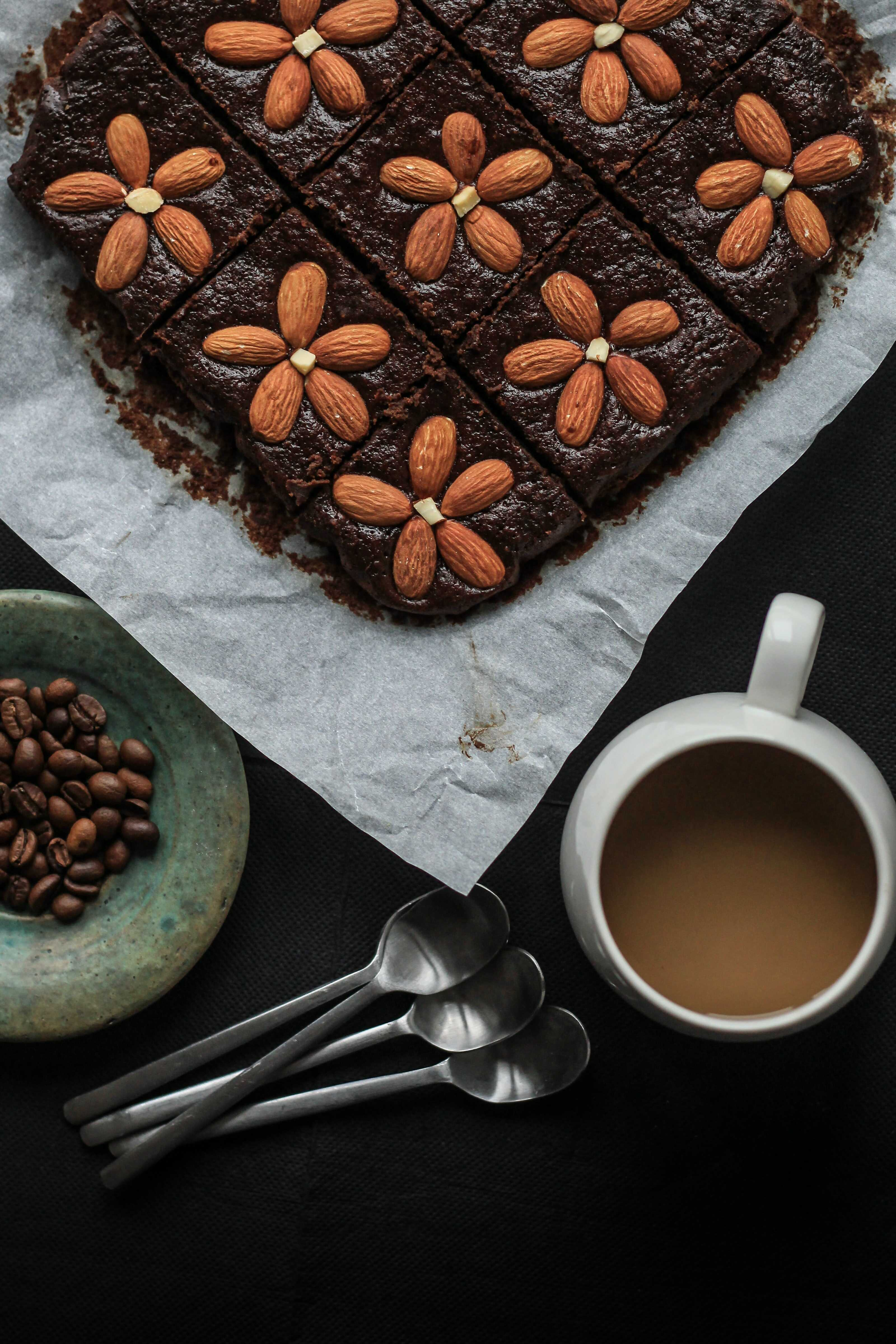 a chocolate cake decorated with almond as a flower
